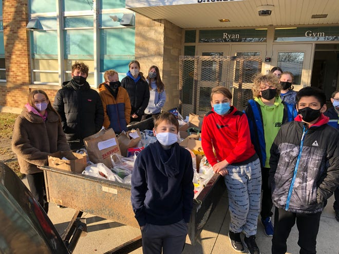 Sacred Heart Catholic School students in Boone help sort the food donations.