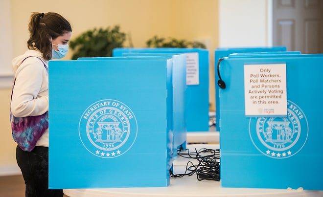Emily Murdock votes in Georgia's much-anticipated runoff election in Evans on Tuesday morning. Republican Sens. Kelly Loeffler and David Perdue are being challenged by Democrats Jon Ossoff and Rafael Warnock.
