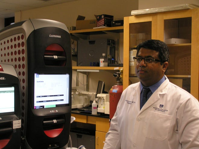 Dr. Ravindra Kolhe, director of the Georgia Esoteric and Molecular Laboratory at Medical College of Georgia at Augusta University, shows the lab where some of the COVID-19 testing is performed.