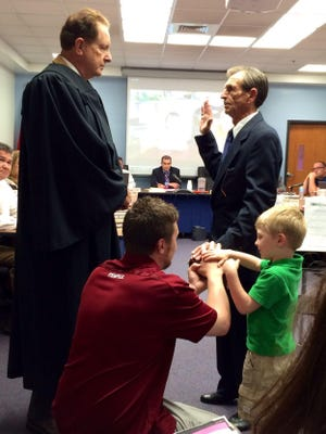File- Robert Wagner swears in Jerry Bachman in 2015.Wagner resigned Monday.