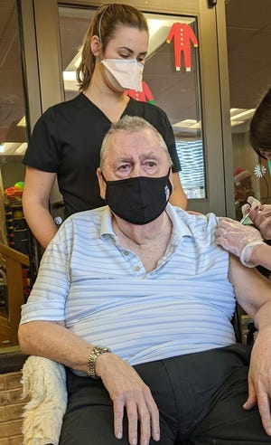 Ken Barton, a resident at Wesley Enhanced Living Doylestown receiving the first dose of his COVID-19 vaccine.