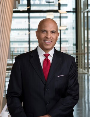 """Constitutional law professor and CNN contributor Michael Higginbotham will deliver the keynote address for the Midland Women's Civic Club's annual Martin Luther King Jr. Day celebration. His talk will follow this year's theme,""""Come Together: Only in Darkness Can You See the Stars."""""""