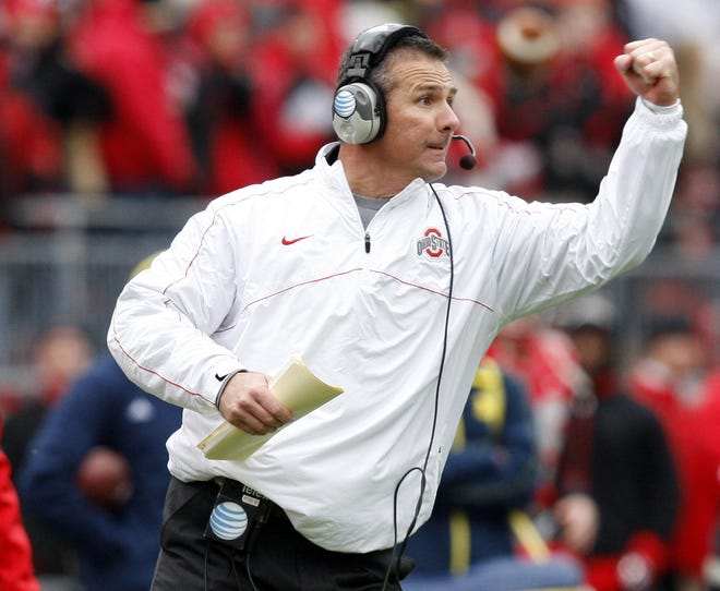 Ohio State Buckeyes head coach Urban Meyer gives his offense a fist pump during the third quarter of the NCAA football game against Michigan at Ohio Stadium in Columbus on Nov. 24, 2012. (Adam Cairns / The Columbus Dispatch)