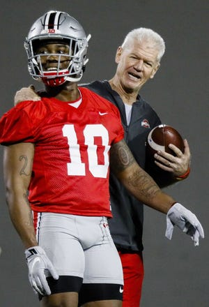 Ohio State defensive coordinator Kerry Coombs embraces freshman receiver Mookie Cooper during an early spring football practice at the Woody Hayes Athletic Center. [Joshua A. Bickel/Dispatch]
