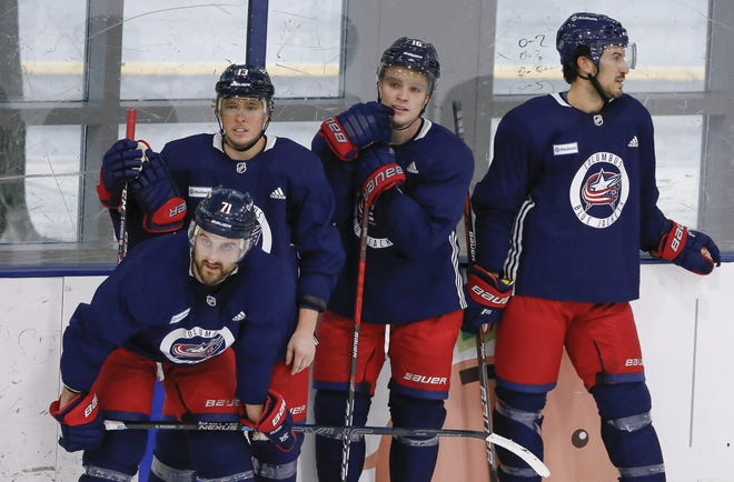 Blue Jackets fowards including, from left, Nick Foligno, Cam Atkinson, Max Domi and defenseman Michael Del Zotto will be looking for an uptick in scoring punch this season without sacrificing gritty play on defense.