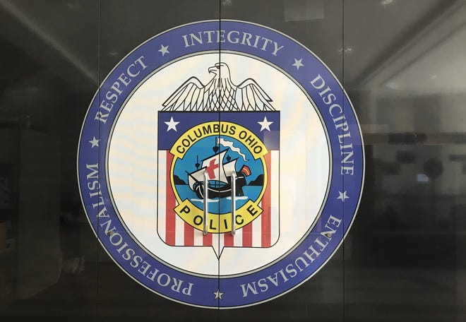 The Columbus Division of Police emblem is on display at the police headquarters building in Downtown Columbus, in this photo taken Aug. 23, 2018.