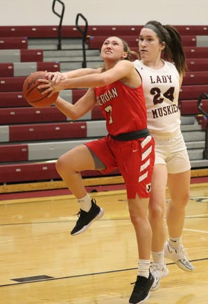Sheridan's Bailey Beckstedt (3) is fouled by John Glenn's Madeline Winland (24) while attacking the basket during Monday's Muskingum Valley League game at John Glenn High School on Monday.