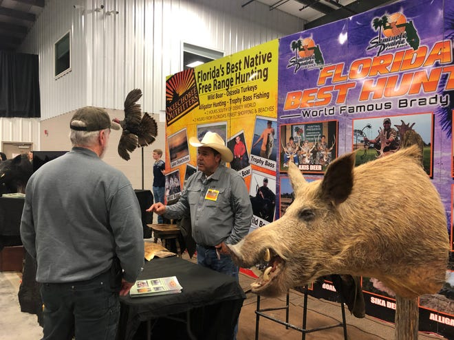 Dean Davis of Dover talks with Danny Santangelo from Sportsmen's Foundation for Military Vets at the 2020 Sportsman Show. This year, the show will be down 30-40 vendors from last year, and no outfitters from Canada will be at the show as the border is closed due to the pandemic.