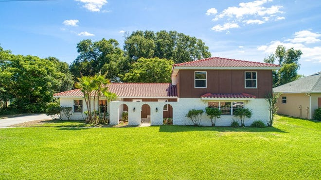 This two-story Spanish-style home, located in the heart of Ormond, has tons of character and charm.