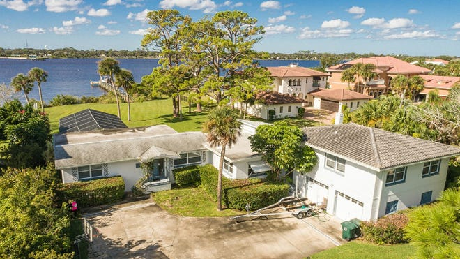 Enjoy beautiful sunsets from this waterfront pool home, which underwent more than $125,000 in renovations in 2019, including a new dock, with a 10,000-pound boat lift.
