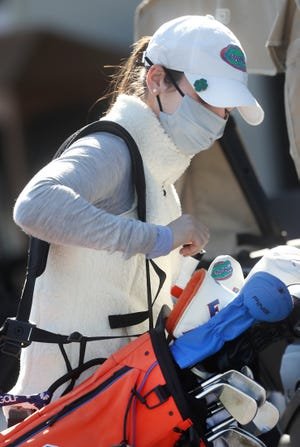 Florida Gator golfer Maisie Filler's mask indicates it'll be a different Sally tournament this week at Oceanside in Ormond Beach. Jan. 5, 2021.