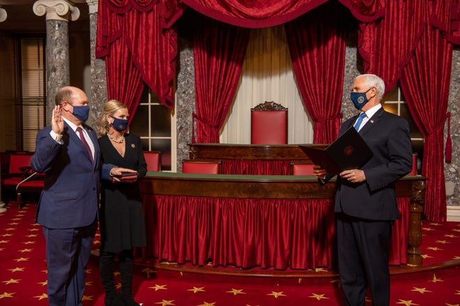 Sen. Chris Coons, D-Delaware, and his wife Annie Coons recreate the swearing-in ceremony with Vice President Mike Pence in the Old Senate Chamber at the Capitol Building in Washington, D.C., on Jan. 3. Coons was recently tapped to serve as chair of the Senate Appropriations Committee.