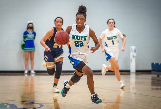 Blue Springs South guard Saneea Bevley (23) pushes the ball up court on a fast break in Monday's game against William Chrisman. Bevley scored 14 points to help the Jaguars overcome a 10-0 deficit to claim a 49-35 victory.