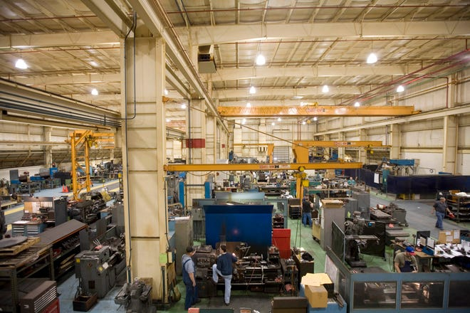 In this file photo, Dresser-Rand employees manufacture and assemble steam turbines in their Burlington facility in Flint Ridge Business Park location on West Avenue. Siemens purchased Dresser-Rand in 2014 before shuttering the plant in 2018. Another company, Integra Pool Covers, has been eyeing the property.