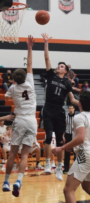 Burlington High School's Nate Spear puts up a shot in the lane Monday night against Washington.