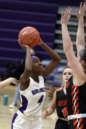 Burlington High School's Ariana Baylark (4) puts up a shot during the first half of the game against Washington High School, Monday Jan. 4, 2021 at Burlington.