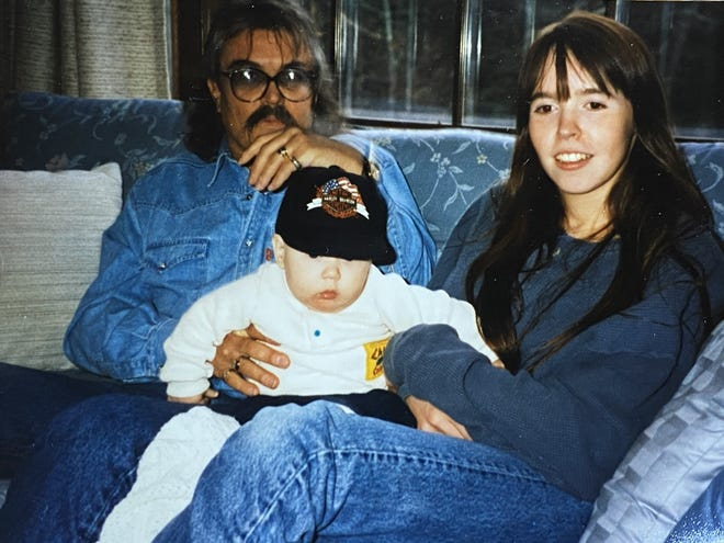 """Kelly Halldorson, right, with her father, Ernie """"Butch"""" Remick, and her son, Wolfgang Halldorson, in one of the only photos Halldorson has with her father. Halldorson is looking for the public's help in finding a lost wooden pendant that her late father carved for her."""