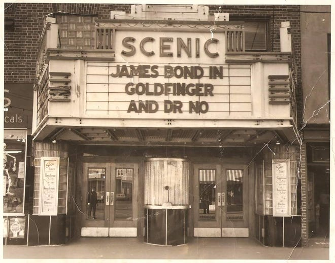 """A historical photo of the former Scenic Theater's marquee. The metal """"Scenic"""" letters were recently found as crews continue work on redeveloping the building as part of an $8 million mixed-use project."""