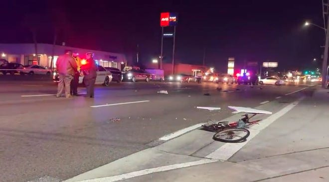 A bicycle remains at the scene of Monday night's fatal crash in the 12000 block of Atlantic Boulevard.