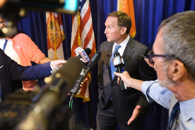 Jacksonville Mayor Lenny Curry fields questions from the media in the summer of 2019.