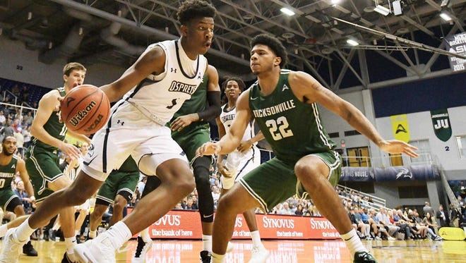 North Florida guard Dorian James tries to get around Jacksonville University's Diante Wood during one of their three games last season. The two teams will play Friday and Saturday at JU.