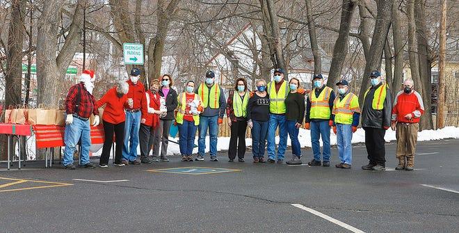 Volunteers served drive-thru dinners to seniors outside the Gardner Senior Center on Christmas Eve.