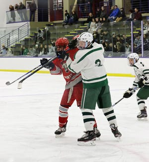 Four-year varsity starter and senior captain Ben Mattson (3), shown in this January 2019 file photo defending a Fitchburg/Monty Tech forward, will lead an experience group of defensemen for the Spartans this winter.
