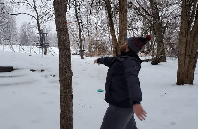Jeff Mallum sinks a putt during the New Year's Icebowl disc golf fundraiser on Friday January 1, 2021 at Richmond Hill Park in Geneseo. Mallum is a longtime volunteer for the course and went on to become the eventual champion of the 2021 Icebowl.