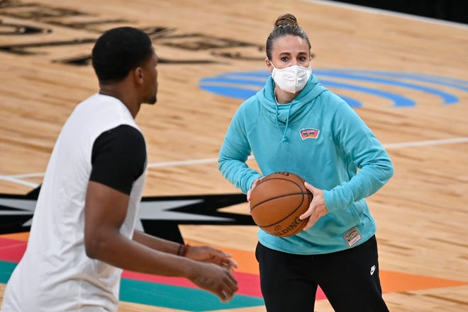 San Antonio Spurs assistant coach Becky Hammon, right, runs drills with forward Rudy Gay before the team's game against the Los Angeles Lakers on Friday, Jan. 1, in San Antonio. (AP Photo/Darren Abate)