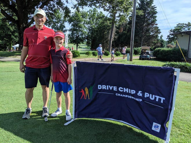 Aaron Byrd poses with his son, Isaac, at a local Drive, Chip and Putt competition held last year.