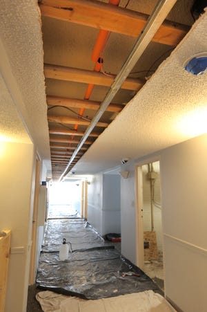 The ceiling was partially removed in the hallway upstairs to install pipes for the fire sprinkler system at Meadowlark Commons.