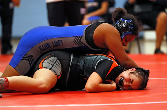 Estacado's Arkajai Walker takes down Dumas' Itzel Escarcega in the 165-pound weight class semifinal match Jan. 2, 2020 during the South Plains Invitational at Monterey High School. Walker won the bout with a pin at 5:36 minutes, but will not know when her 2021 regular season begins due to the COVID-19 pandemic. [Brad Tollefson/A-J Media]