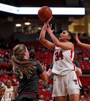 Texas Tech's Lexi Gordon (34) goes up for a shot during the Lady Raiders' 89-84 home victory last January against Oklahoma. The two teams play again at United Supermarkets Arena at 6 p.m. Wednesday. [BRAD TOLLEFSON/A-J MEDIA FILE PHOTO]