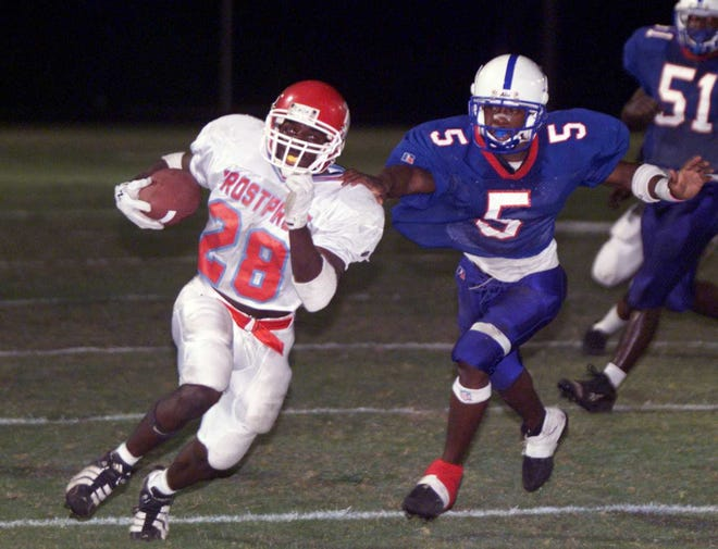 Frostproof's C.J. Hudson (28) is tackled from behind by Pahokee's Charles Edwards during a playoff game in 1998. Hudson is Polk County's all-time leading rusher.