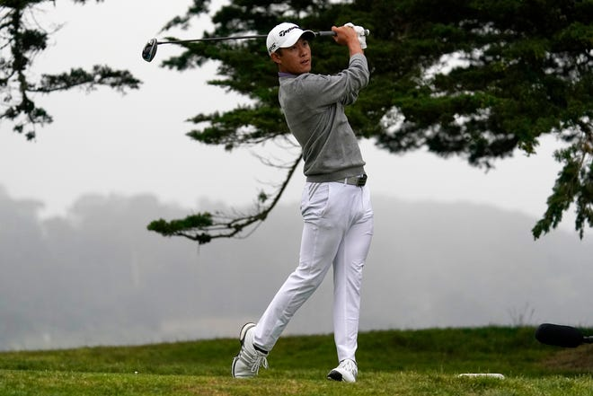 FILE - In this Sunday, Aug. 9, 2020, file photo, Collin Morikawa watches his tee shot on the 16th hole during the final round of the PGA Championship golf tournament at TPC Harding Park in San Francisco. His drive to 7 feet for eagle was the defining moment of his first major title.
