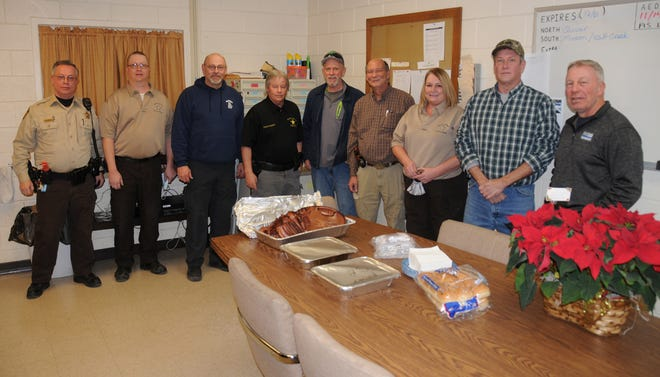 Mason FOP: The Mason County Sheriff's Department in Havana when food was delivered on Christmas Eve. Pictured are members from the Mason County Sheriff's Department including Mason County Sheriff Paul Gann, fourth from the left in the black shirt; Lodge 427 President Ike Hackett, fifth from left standing beside Sheriff Gann; and Lodge 427 Secretary Karl Williams, second from right.