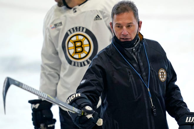 Bruins head coach Bruce Cassidy instructs his players at the team's NHL hockey training camp, Monday, Jan. 4, 2021, in Boston.