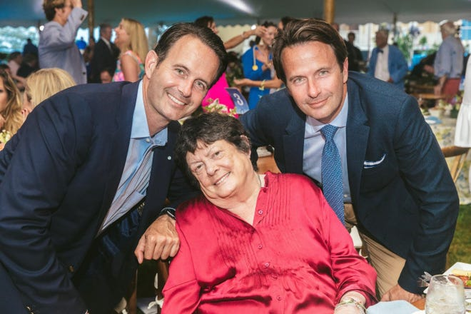 "Members of the Prince family pose for a photo after their ""Powered by Prince"" Fund at Newport Hospital was honored at the hospital's 2019 Summer Celebration. Left to right: Guillaume de Ramel, Elizabeth ""Lisette"" Prince, and Regis de Ramel."