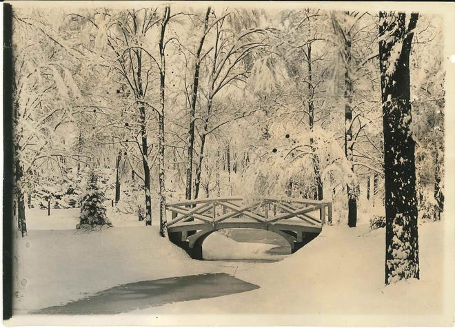 """Pretty as a postcard is this scene taken years ago at the Frederick T. Proctor Park, at Rutger Street and Culver Avenue in Utica. Philip A. Bean, executive director of the Central New York Conservancy, says the park """"has long been considered the 'crown jewel' in the city parks and parkway system."""" One of the reasons is its elegant bridges, which have been restored by the Conservancy's contributors and volunteers. The park was designed in 1913-14 by famed landscape architect Frederick Law Olmsted Jr. It was given to the city in 1923 by Maria Williams Proctor, widow of Thomas R. Proctor. It is listed on the National Register of Historic Places."""