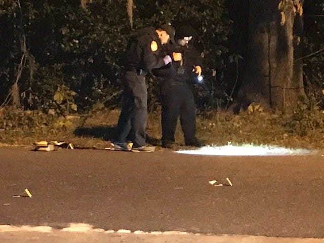 Ocala Police officers process the shooting scene Monday night in northwest Ocala. One man was hit and injured.