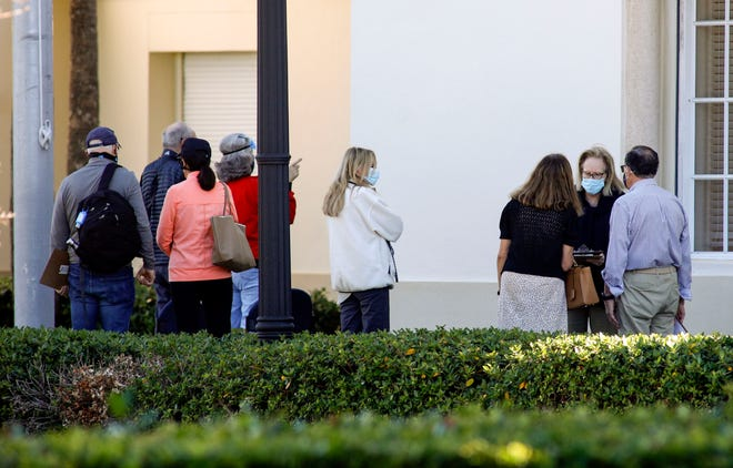 Palm Beach Town Council president Maggie Zeidman (second from right) speaks with residents in front of Fire Rescue Station #3 just before they head inside the station to receive the Moderna COVID-19 vaccine on Tuesday.