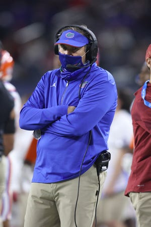 Coaches Dan Mullen of Florida, pictured, and Dabo Swinney of Clemson showed through their words and actions that the pandemic and public good wasn't first on their minds this past season.