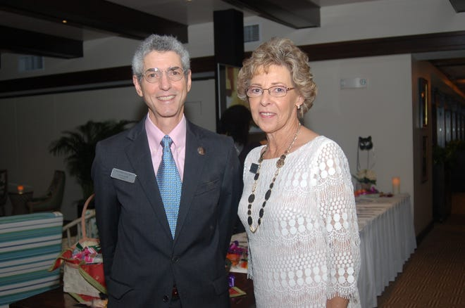 Former Palm Beach Island Cats Executive Director Leslie Moss and the organization's president, David Leavitt, are pictured at the annual Cat's Meow Ball at The Sailfish Club in 2016. Moss retired in December.