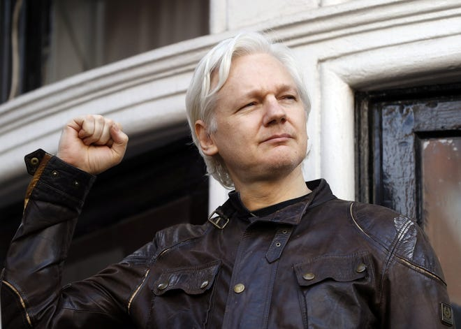 WikiLeaks founder Julian Assange greets supporters in this May 19, 2017, file photo.