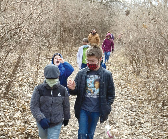 Hikers of various ages took part in the annual First Day Hike at Pratt's Green Trails on January 1, braving the cold weather to get in some outdoor time along with friends and some furry pals.
