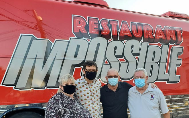"Robert Irvine and his ""Restaurant Impossible"" team from Food Network arrived in Warren in August to film an update from Perella's Ristorante. Pictured are Doreen Perella, son Lou E. Perella, Irvine and owner/chef Louie Perella."