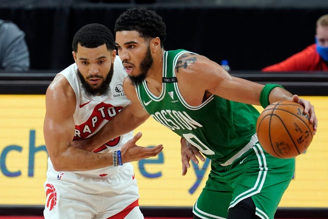 Celtics forward Jayson Tatum, right, drives around the Raptors' Fred VanVleet during the first half of Monday night's game in Tampa. Tatum scored 40 points in the Boston victory.