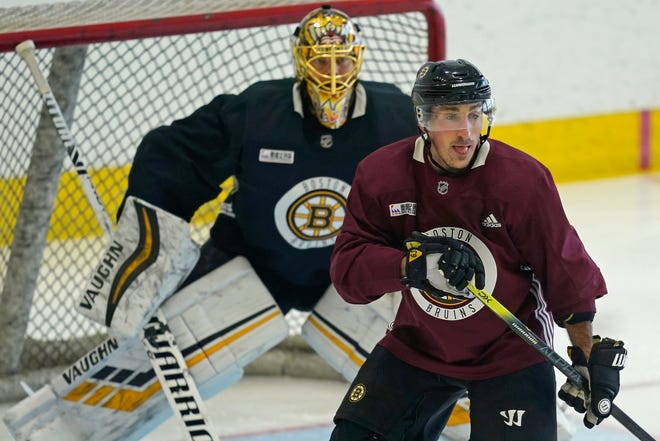The Boston Bruins' Brad Marchand looks for a pass while goaltender Tuukka Rask minds the net during a training camp session, Monday, Jan. 4, 2021 in Boston. [Elisa Amendola/Associated Press]
