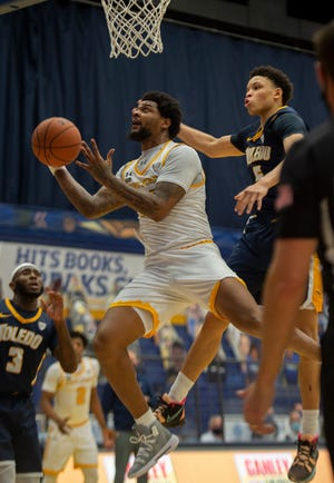 Kent State senior forward Tervell Beck takes the ball to the basket during a game against Toledo played earlier this month at the M.A.C. Center.