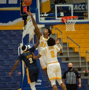 Kent State senior forward Justyn Hamilton blocks a shot by Toledo guard Marreon Jackson during last Tuesday's contest at the M.A.C. Center.